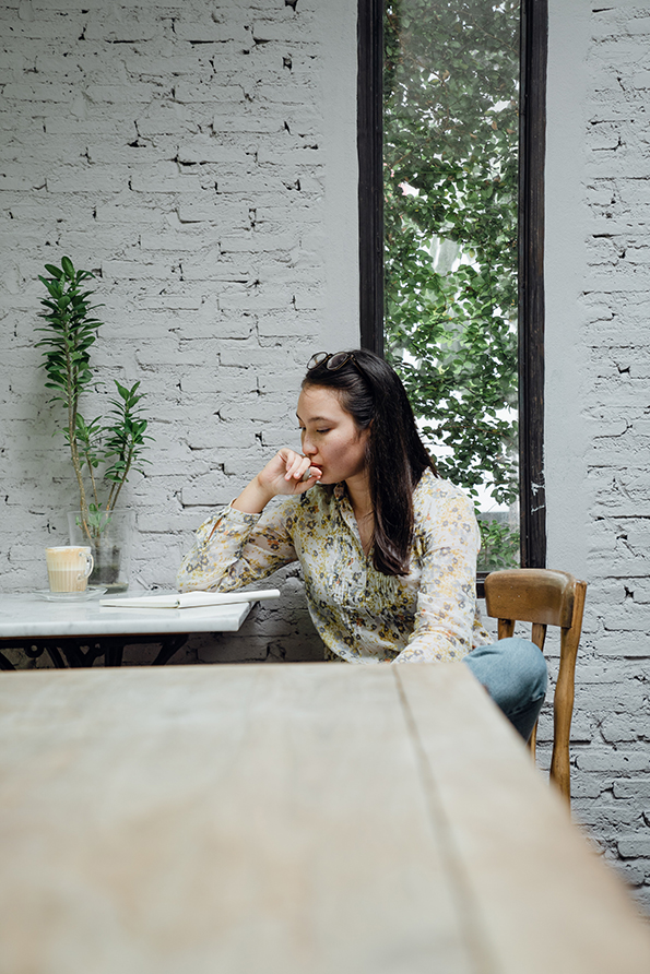 Woman sitting at table