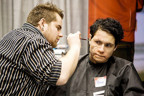 media makeup artist applying special effects tv film