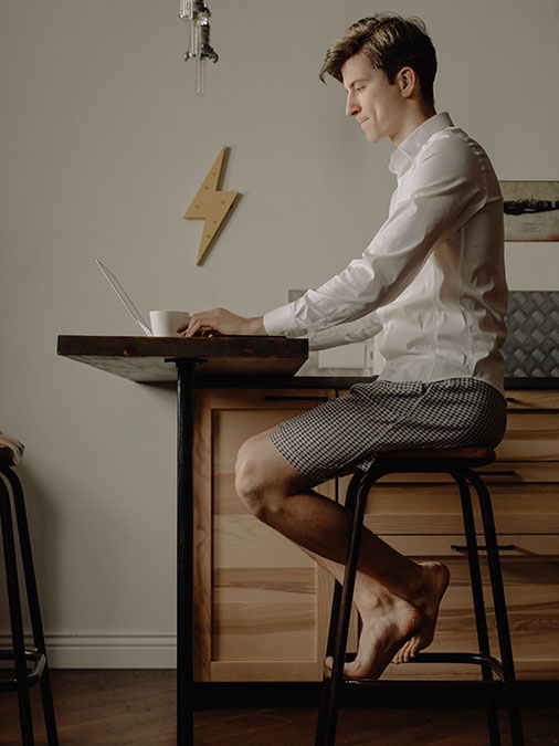 Guy on laptop on table